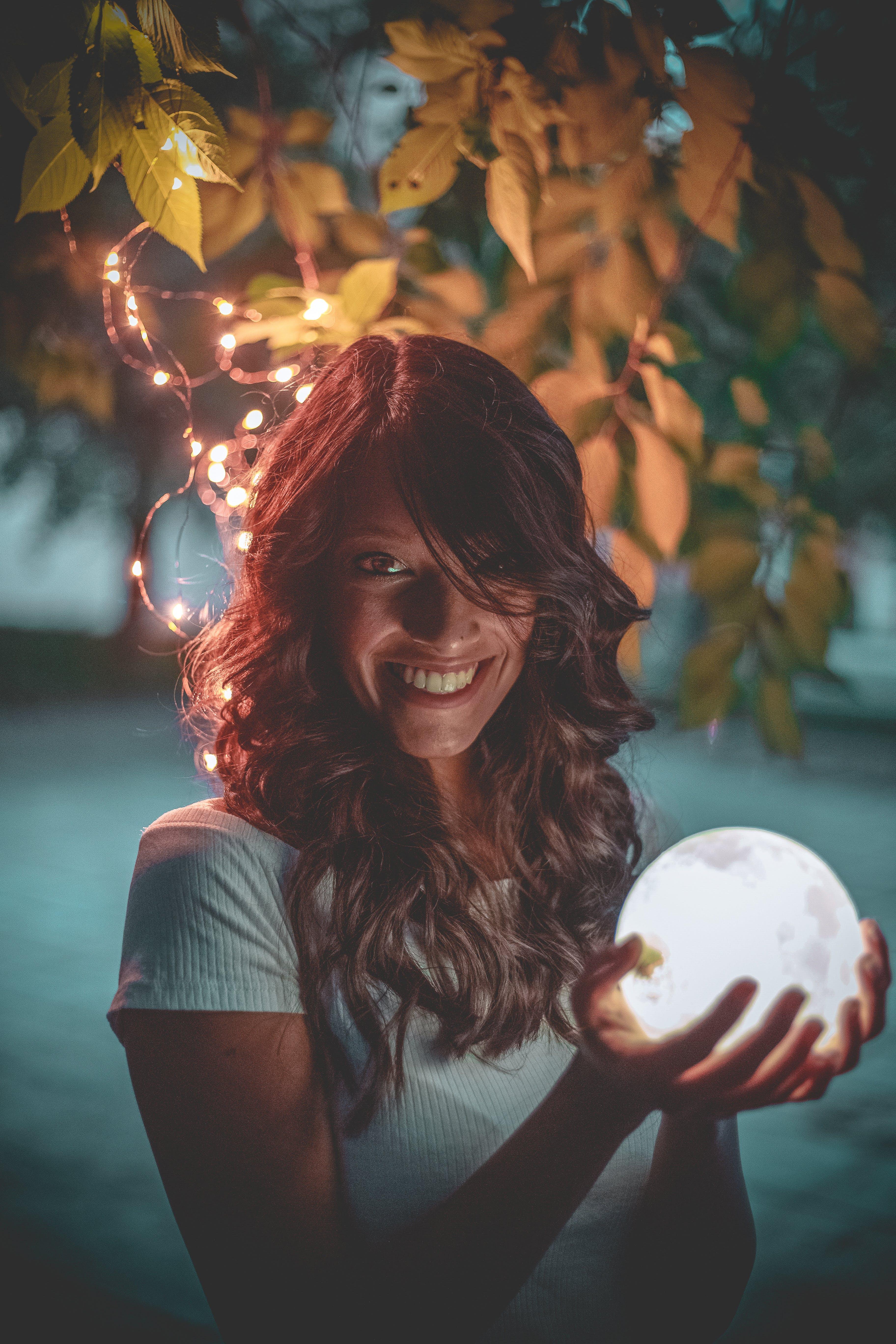 Woman Holding White Led Light