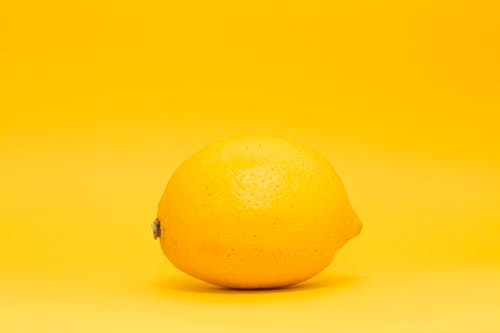 Yellow Lemon Fruit on White Surface