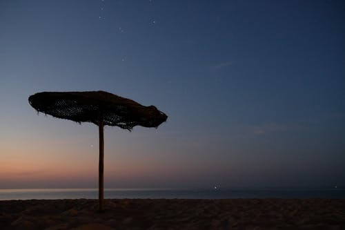 Free stock photo of beach, early morning, parasol, stars
