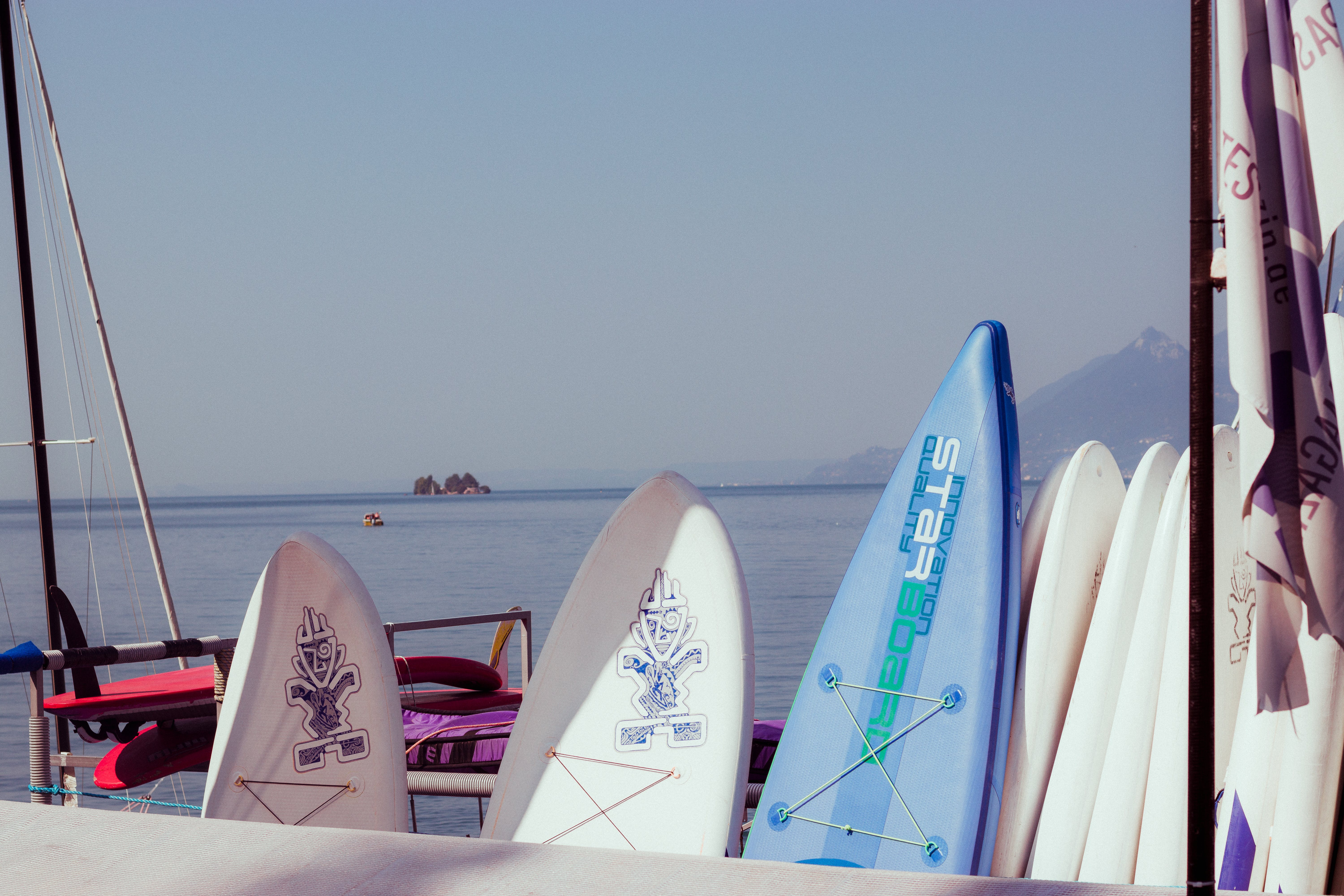 Surfboards Leaning on White Handrails