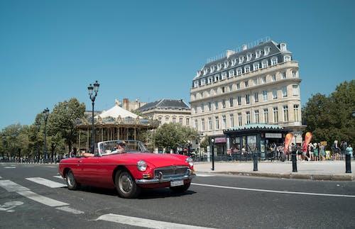 Бесплатное стоковое фото с автомобиль, карусель, классический автомобиль, красный