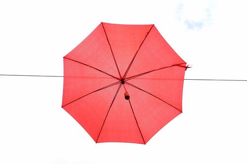 Red Umbrella in Mid Air during Day