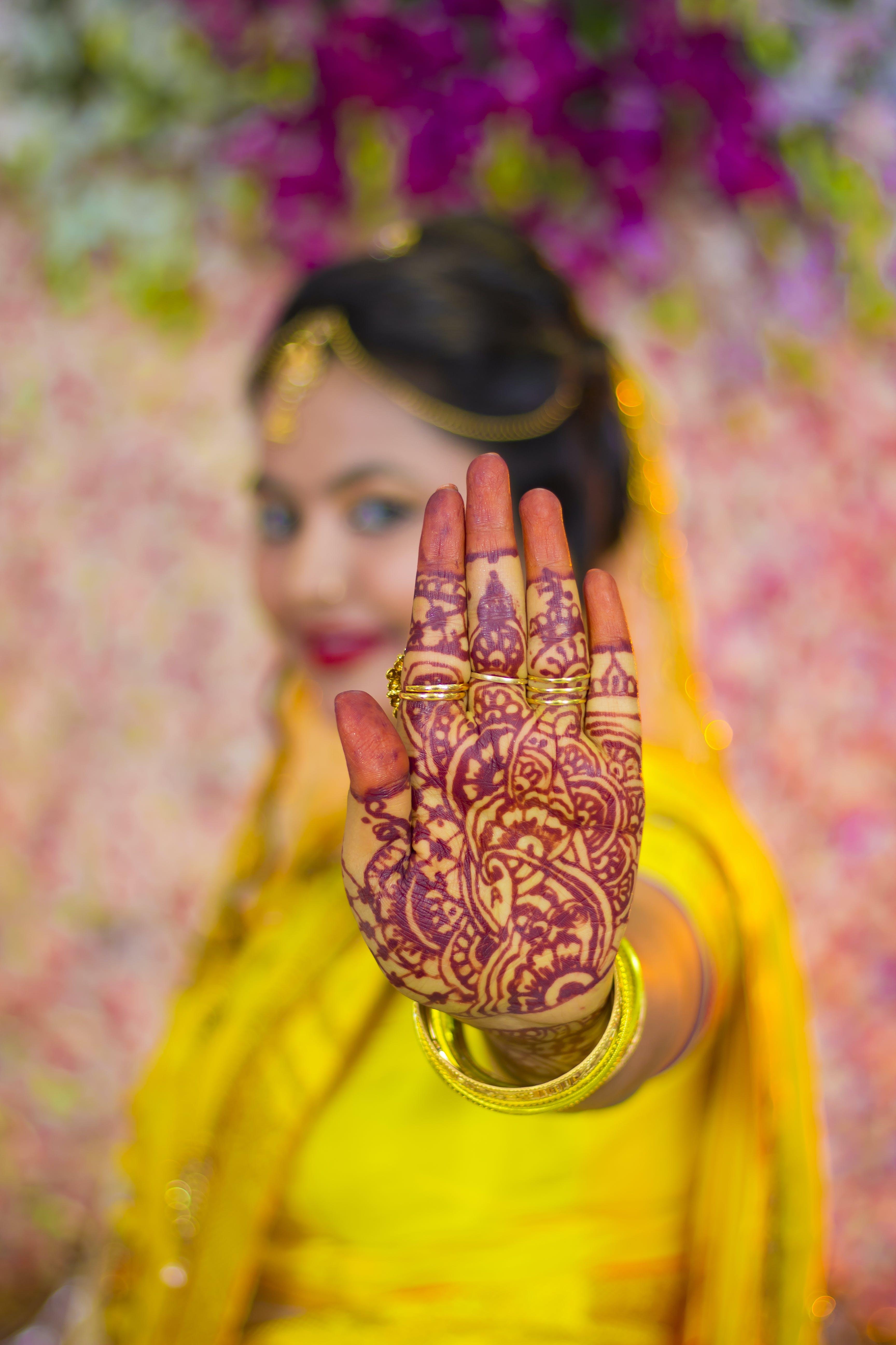 Woman Showing Mehndi Tattoo