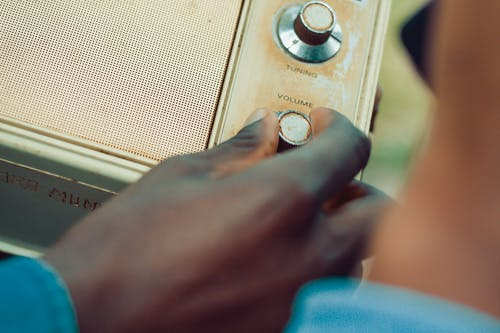 Person Holding Volume Knob