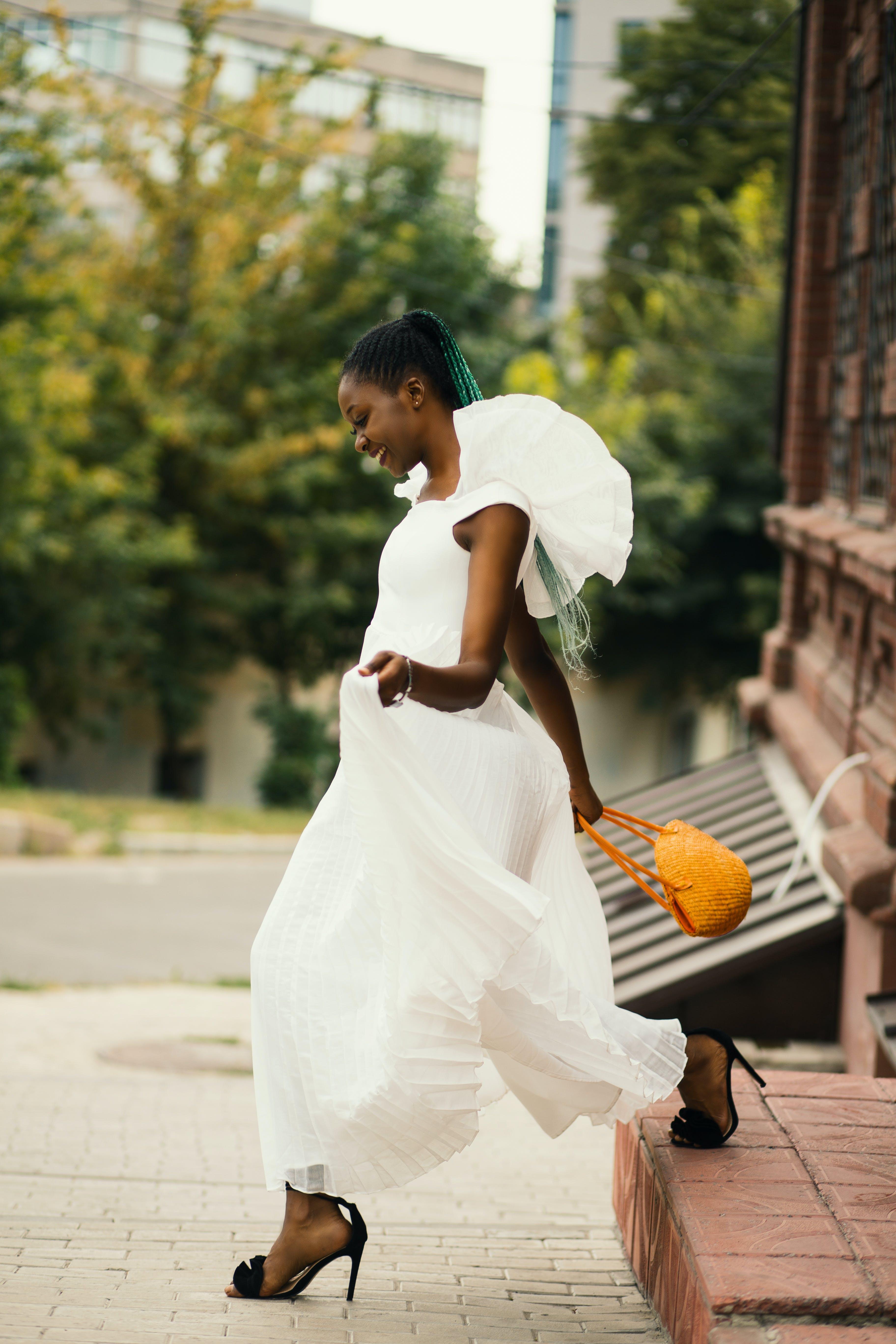 Woman Walking Wearing White Dress