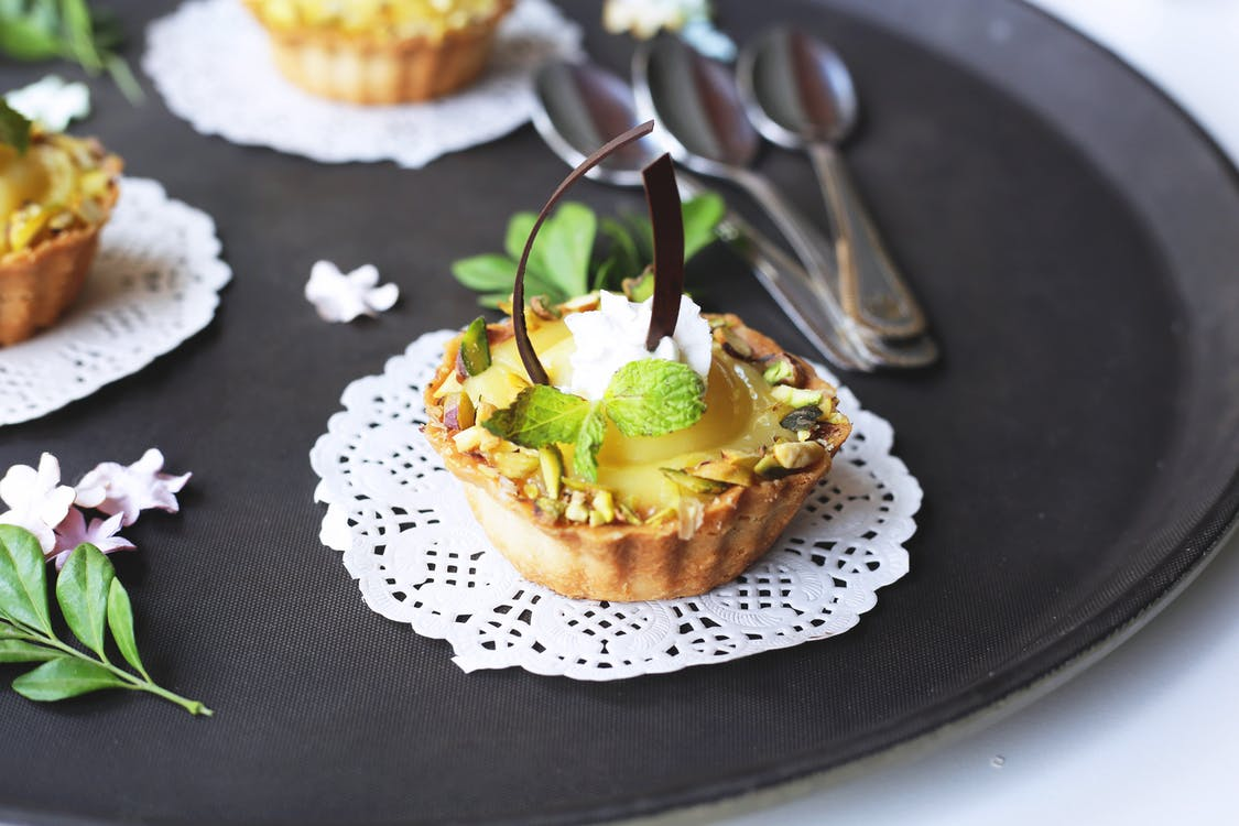Egg Tart With Mint on Black Tray