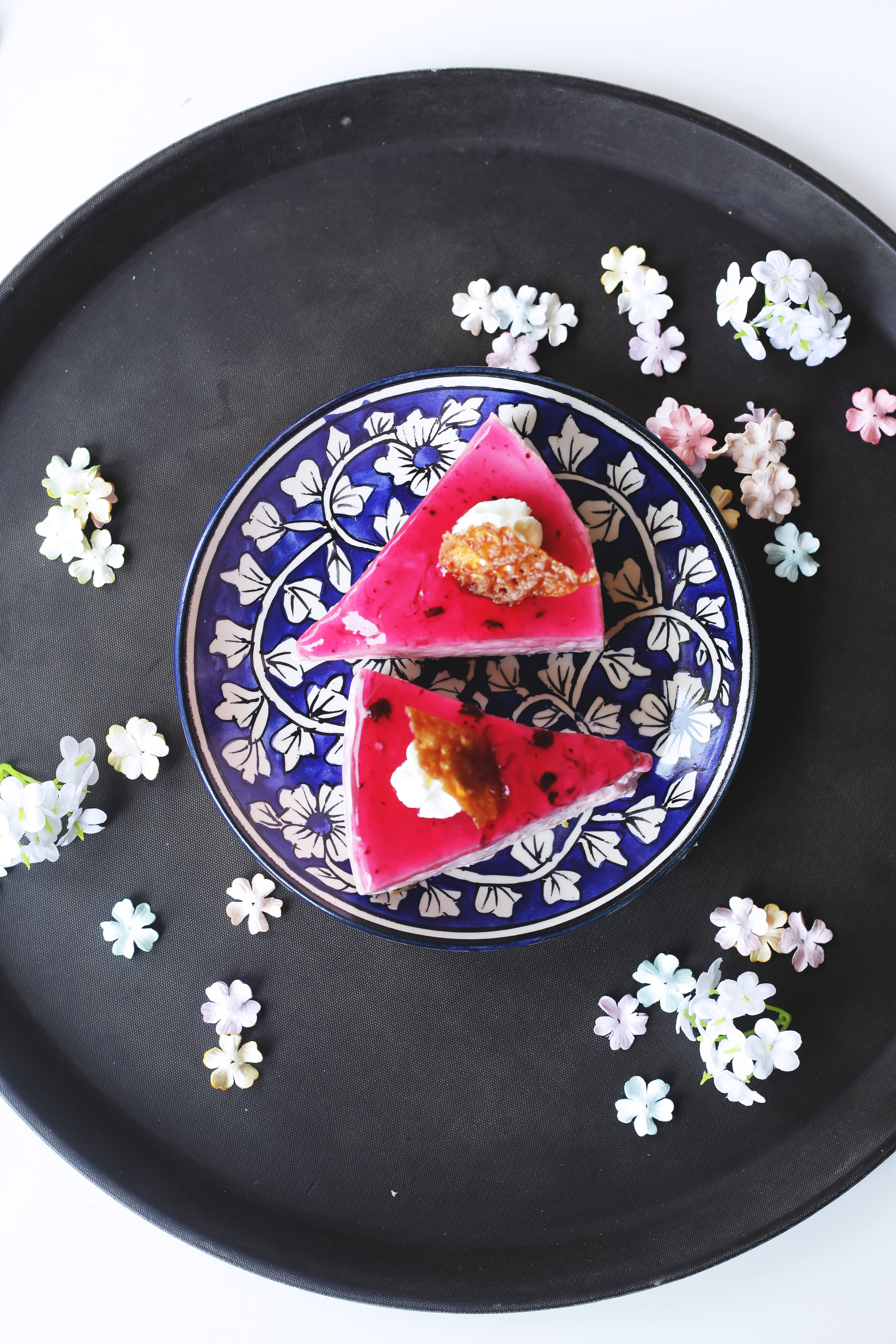 Sliced Strawberry Cake on Plate With Black Tray