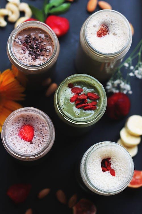 Five Assorted-flavor Milkshakes in Glass Jars