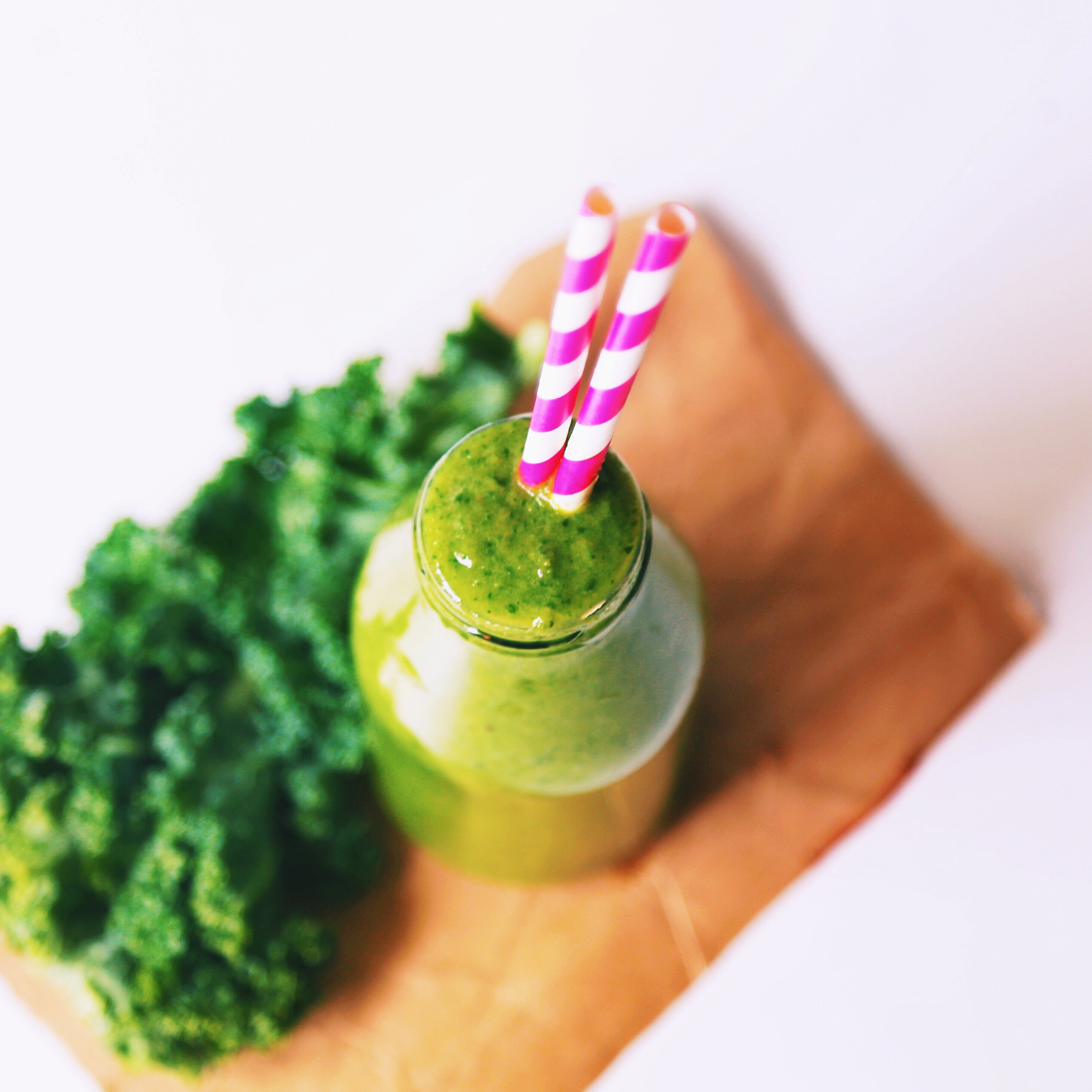 Selective Focus Photography of Vegetable Shake on Brown Wood Board