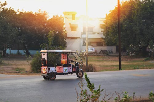 Free stock photo of advertisement, atmospheric evening, auto rickshaw, bright colours