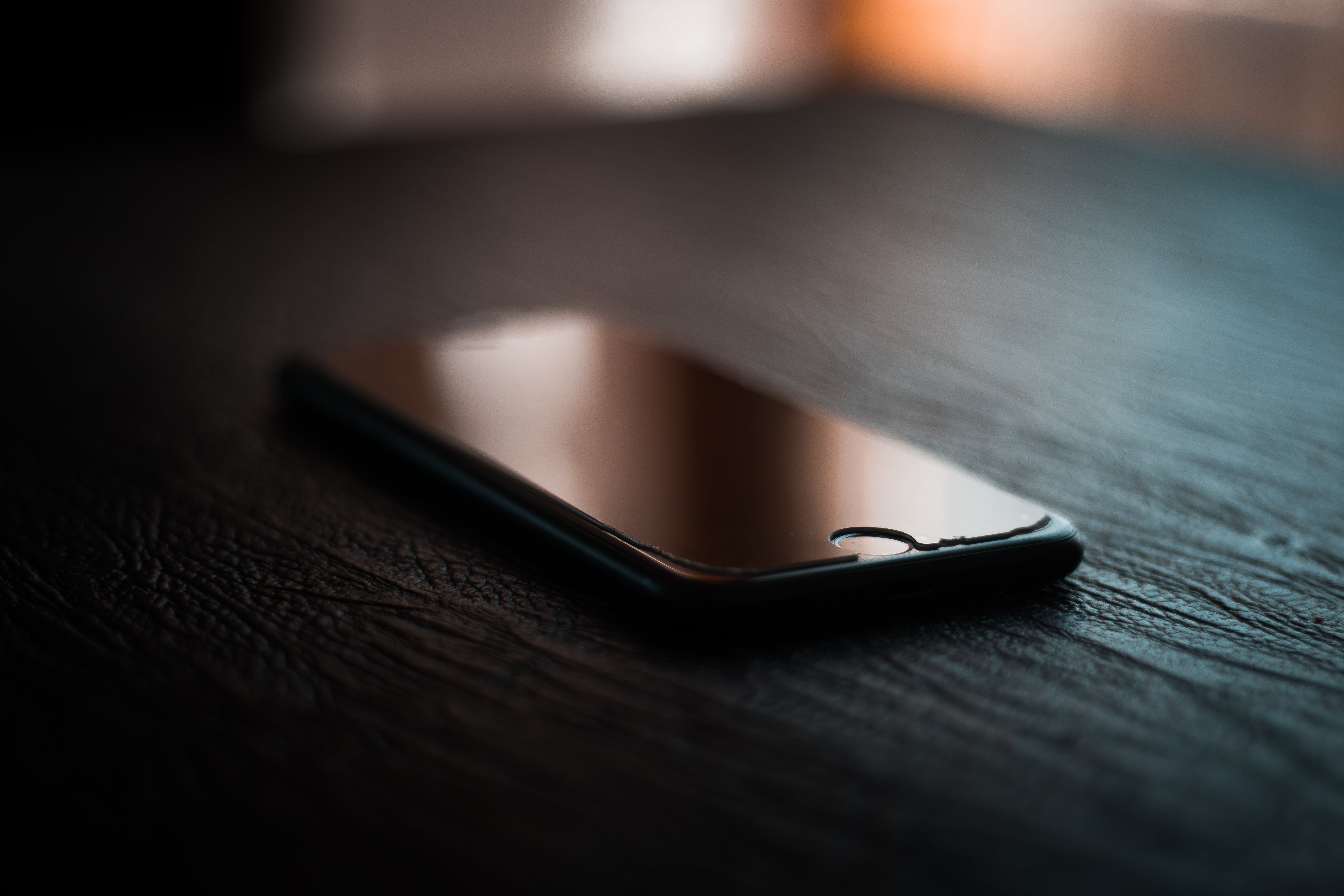 Selective Focus Photography of Black Iphone Turned-off on Table