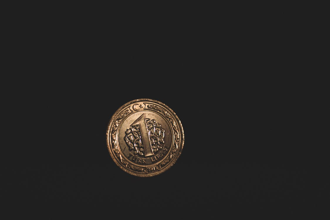 Round Gold-colored 1 Coin
