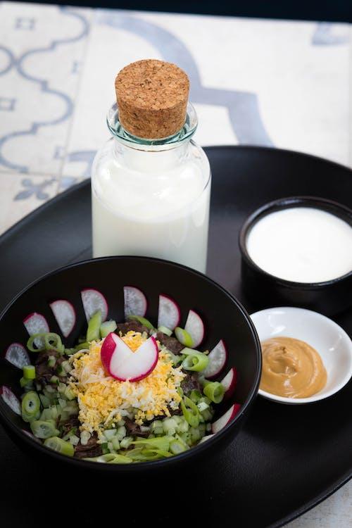 Vegetable Salad Beside Milk Bottle and Brown Sauce Dip on Round Black Tray