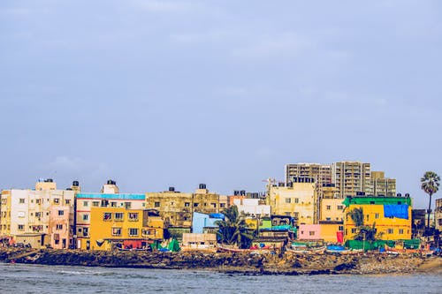 Ilmainen kuvapankkikuva tunnisteilla asuminen, eri värejä, Intia, lähellä rantaa