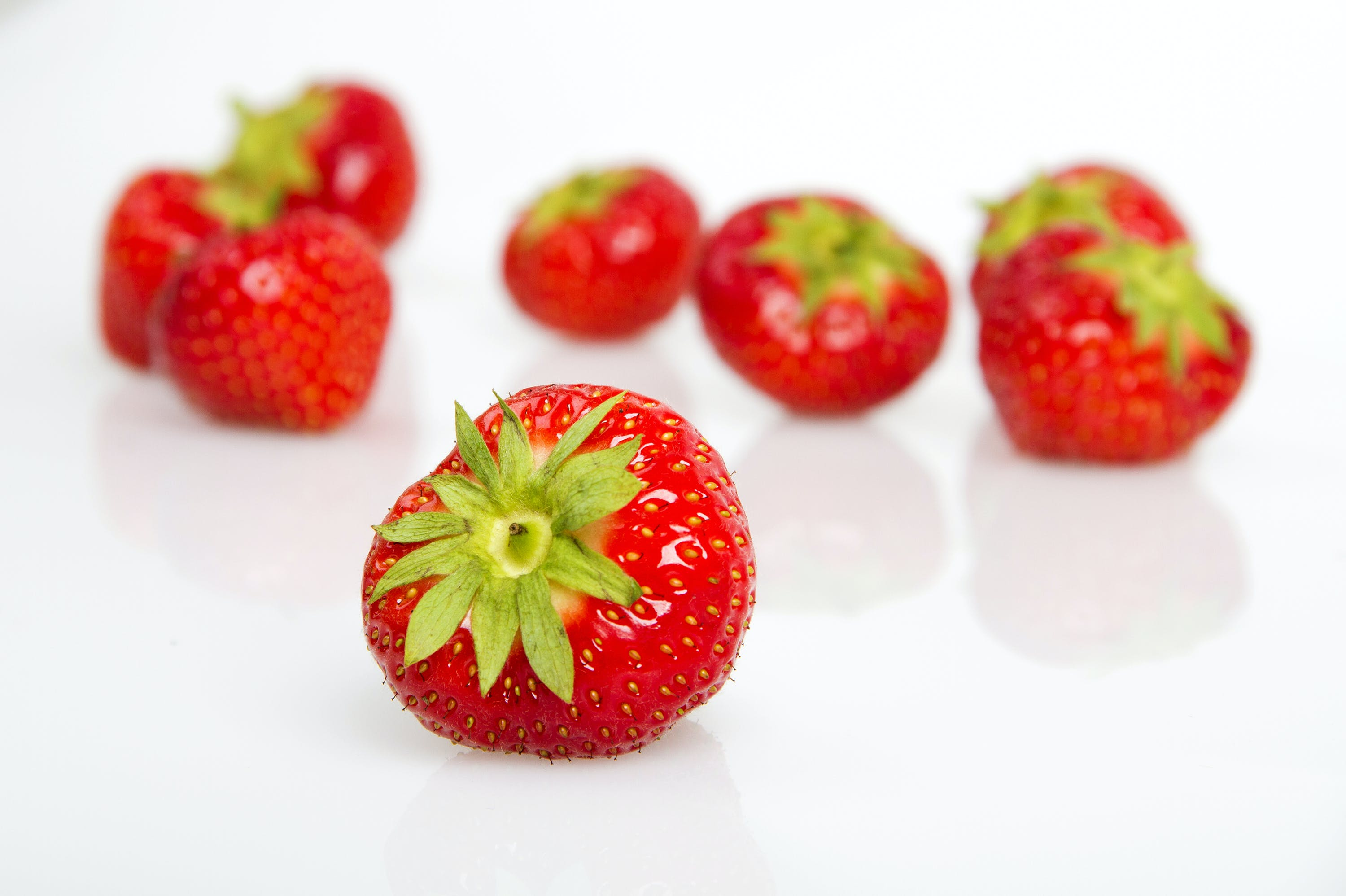 Bunch of Strawberries on White Surface