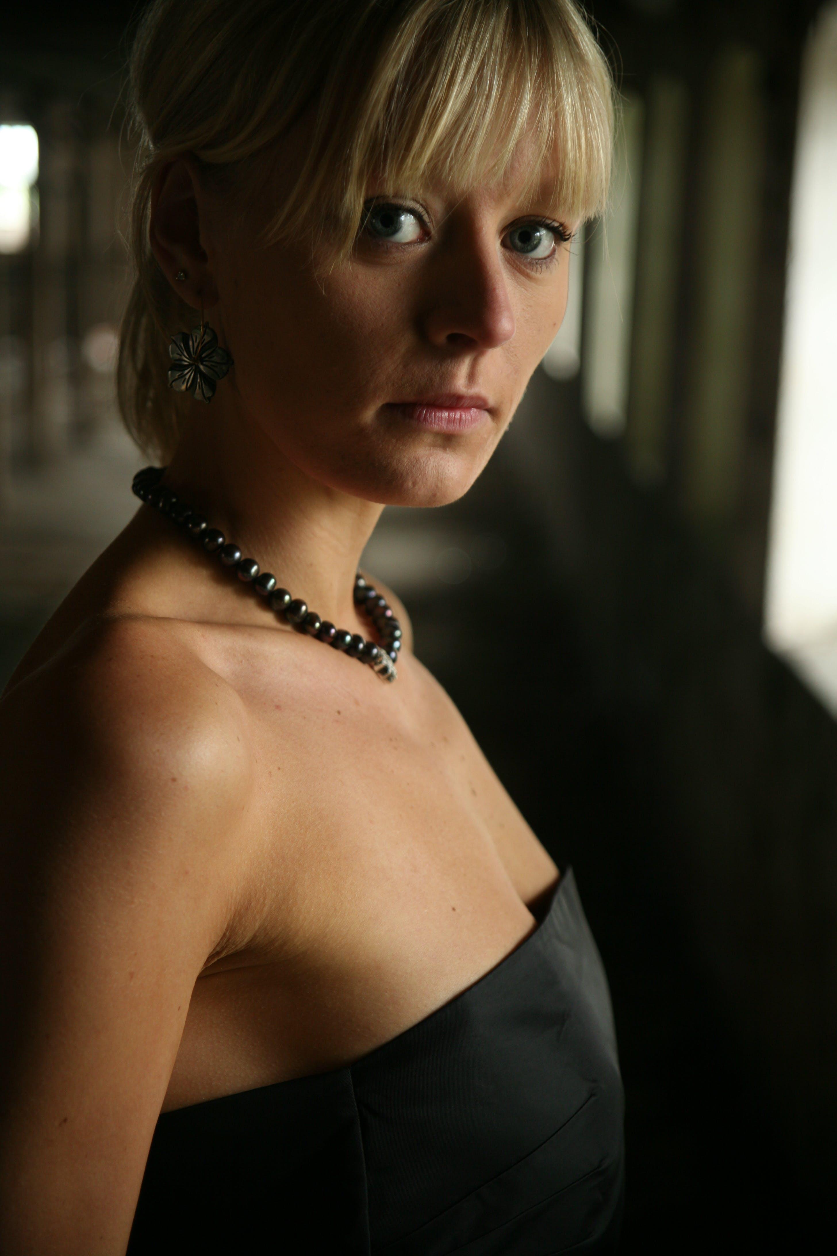 Photo of Woman in Black Tube Dress
