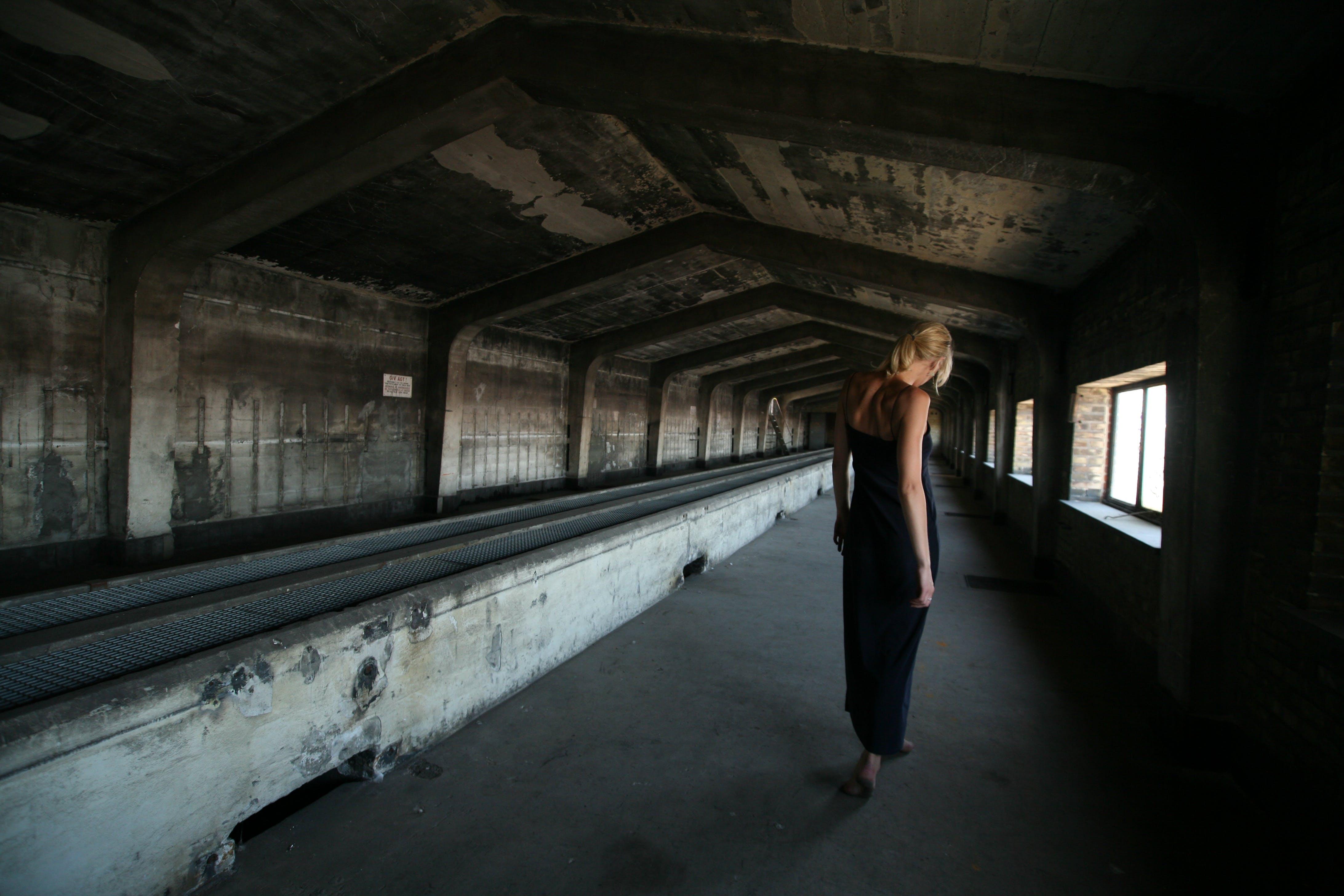 Woman Standing Inside Attic