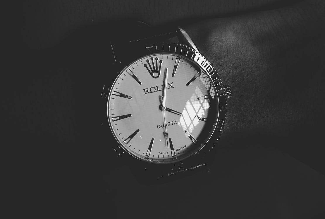 Round White Silver-colored Rolex Analog Watch Displaying 4:03 Time