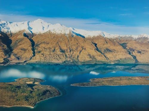 Gratis lagerfoto af bjerg, dagslys, hav, landskab