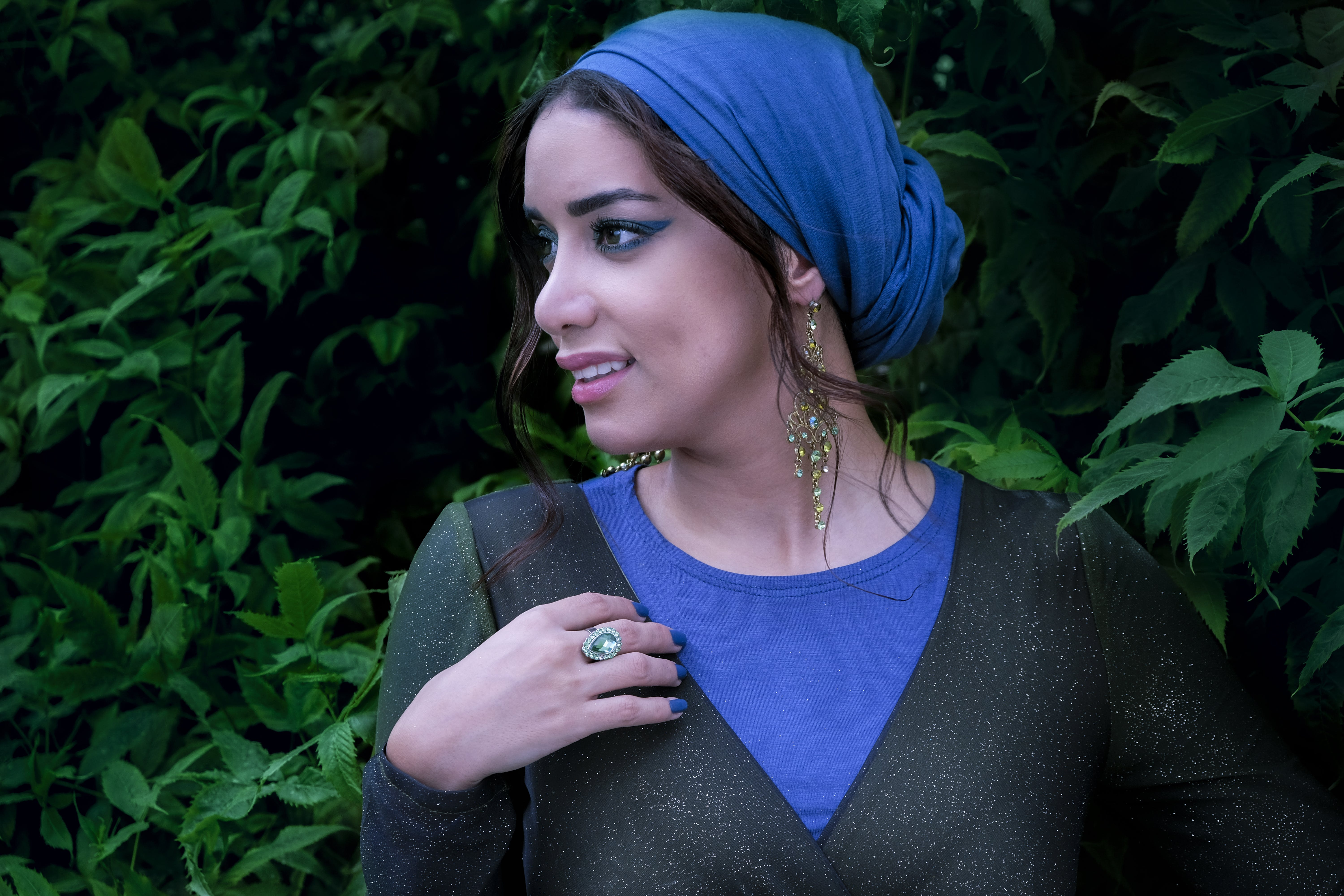 Woman Wearing Blue and Black Crew-neck Top