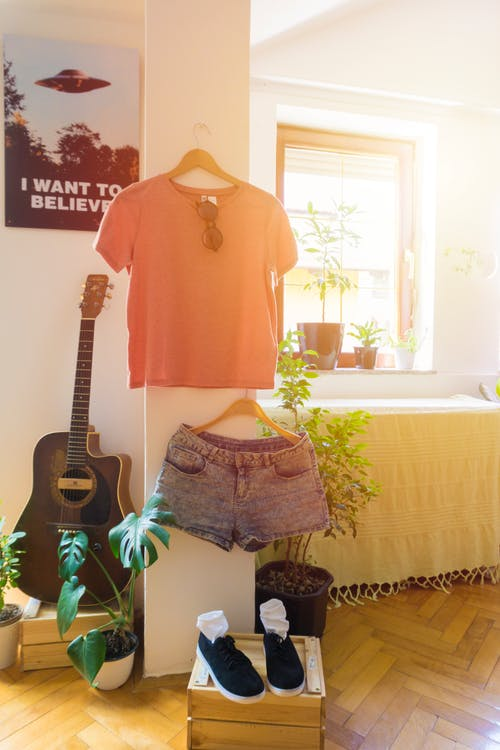 Black Squared-off Acoustic Guitar Near Shirt, Shorts and Shoes