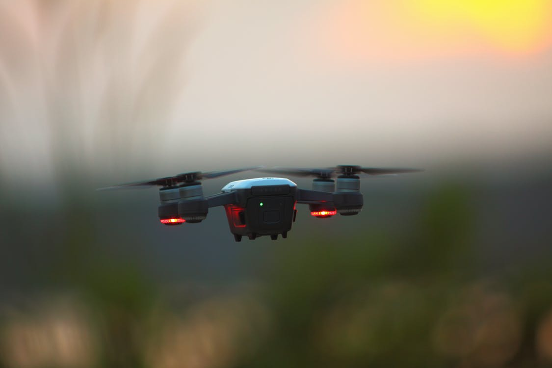 Selective Focus Photography of Red Quadcopter