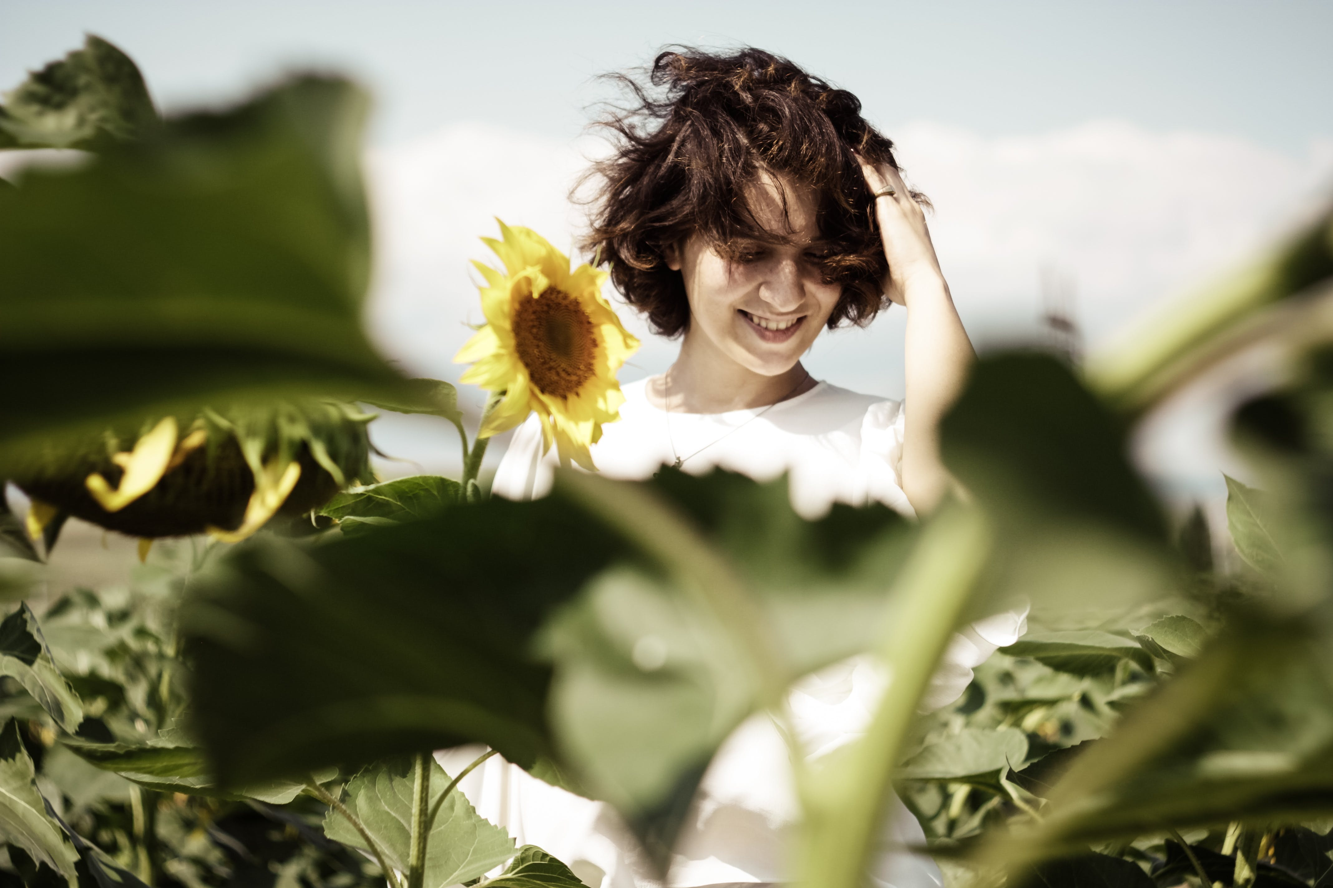 Woman Standing in the Middle of Sunflower Field