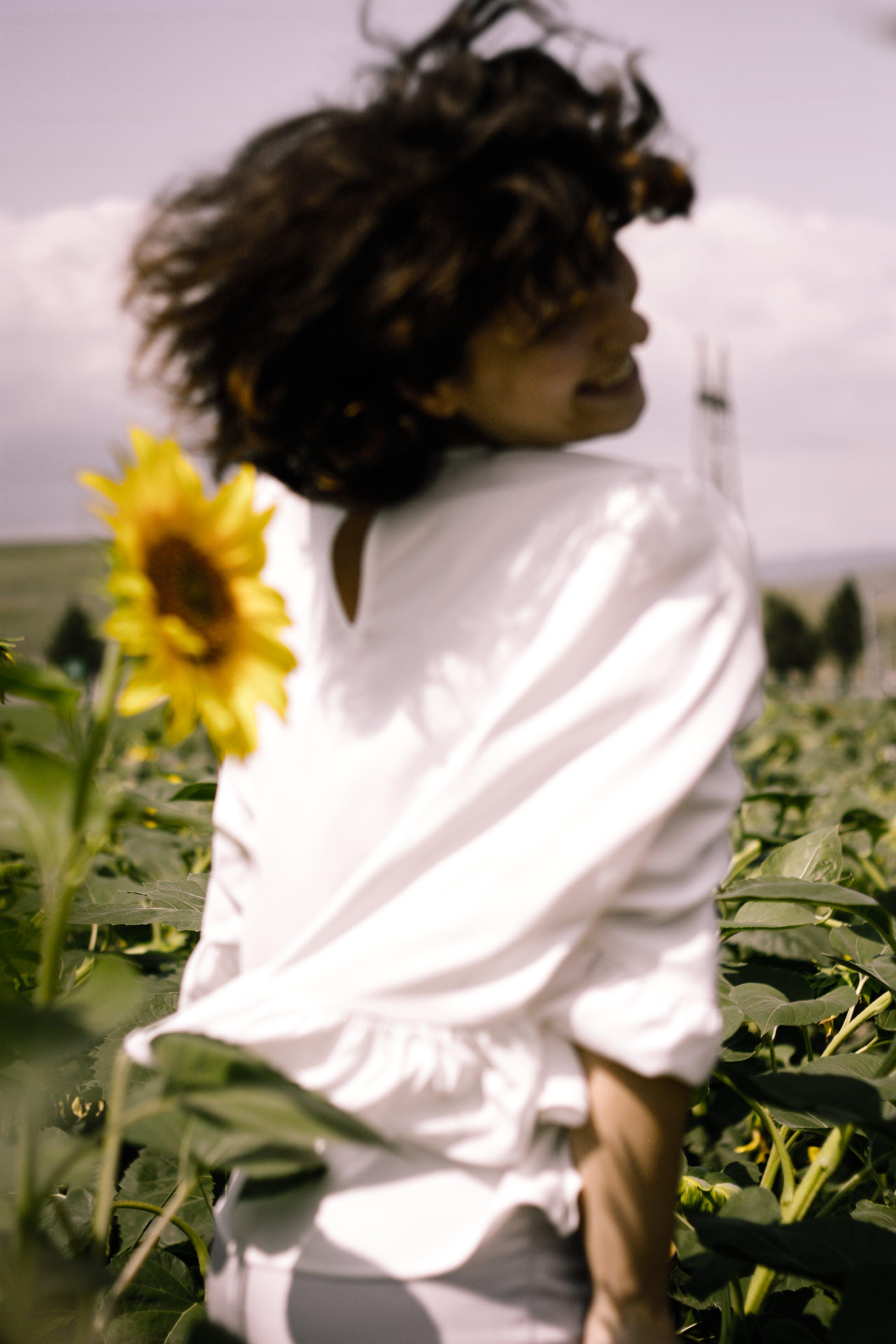 Photo of Woman on Sunflower Field