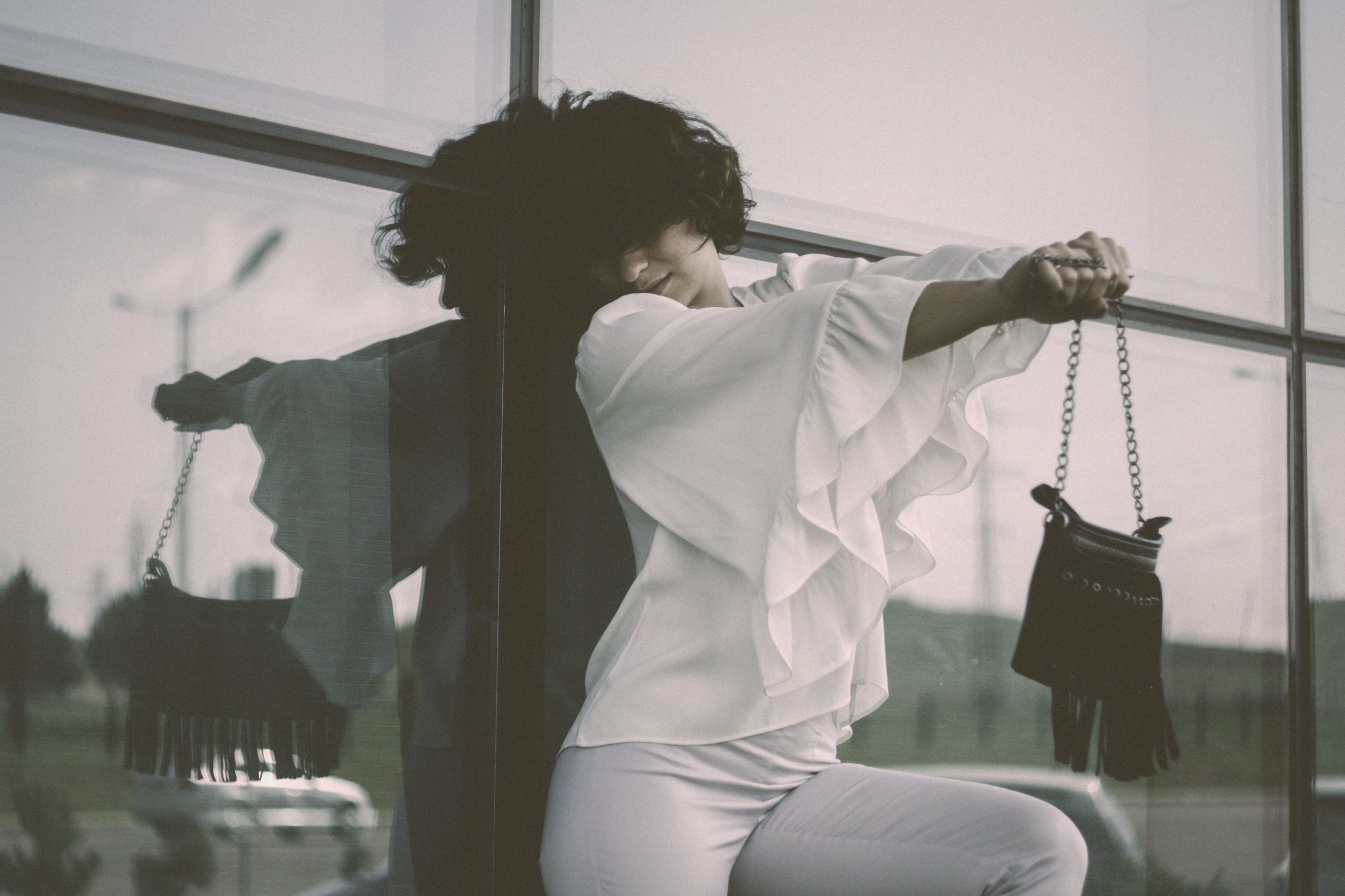 Woman Wearing White Long-sleeved Shirt