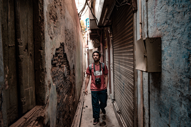 Man Standing Beside Gray Roll-up Door