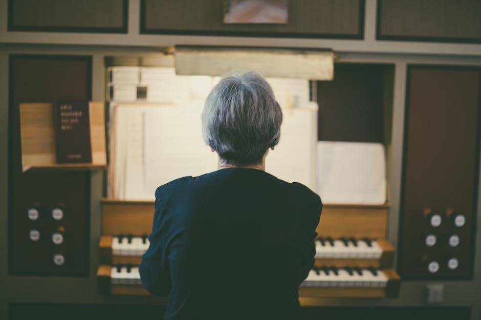 Back view of woman playing organ
