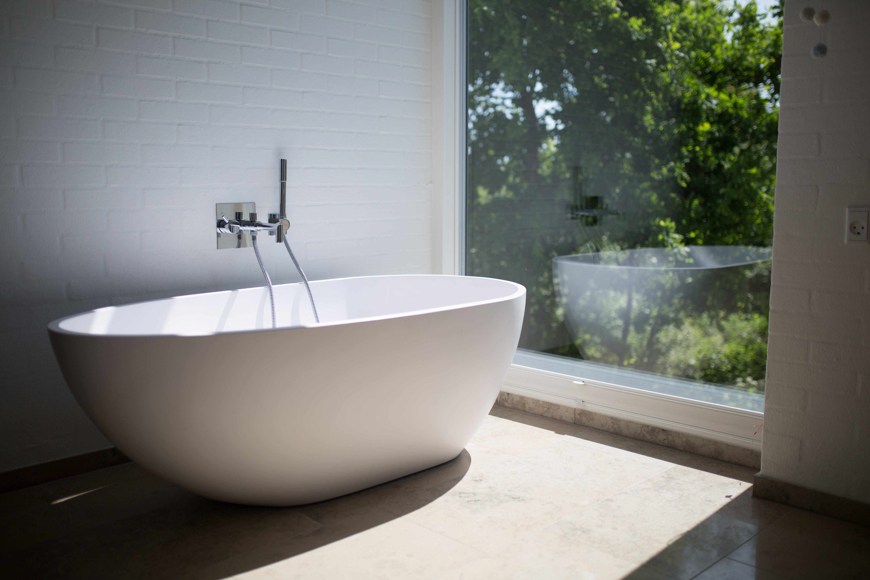White Ceramic Bathtub Beside Clear Glass Wall