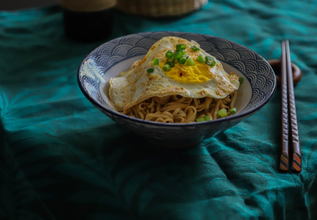 Bowl Of Noodles With Sunny Side Up Egg