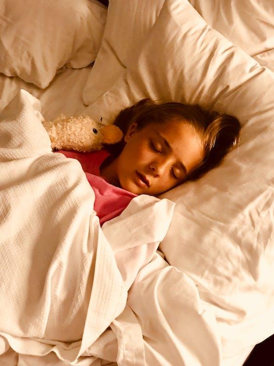 Girl Sleeping on Bed