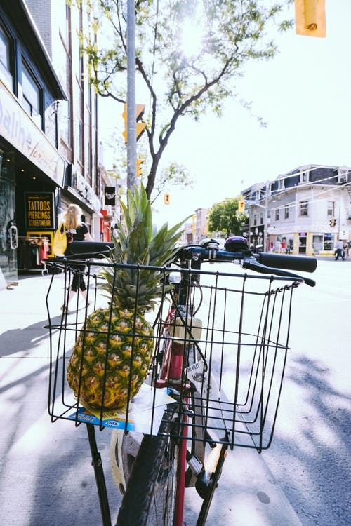 Green Pineapple Fruit in Bicycle Basket