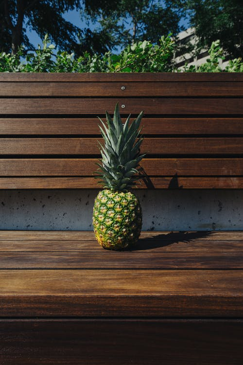 Pineapple on Wooden Bench
