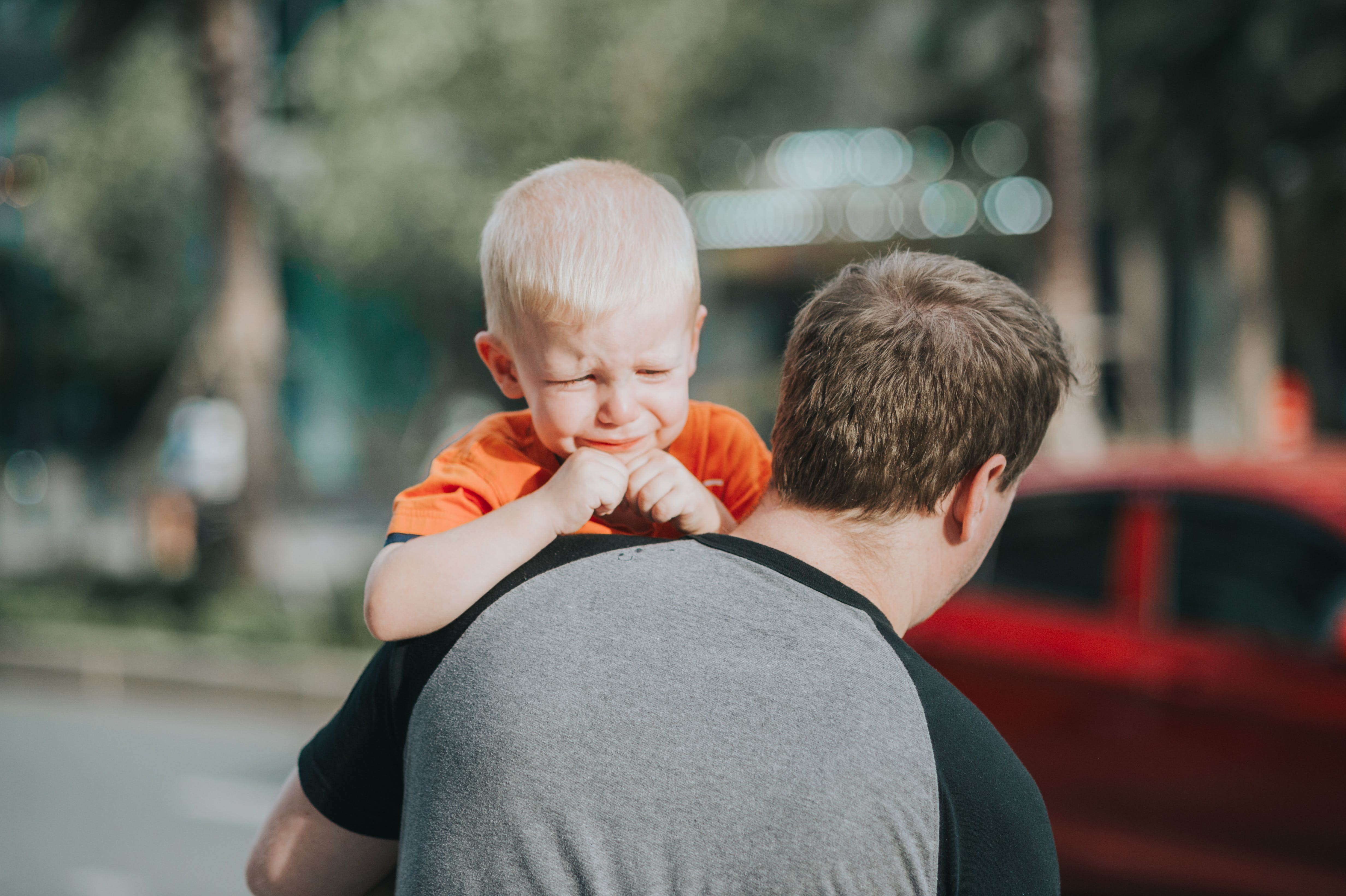 Man Carrying Child