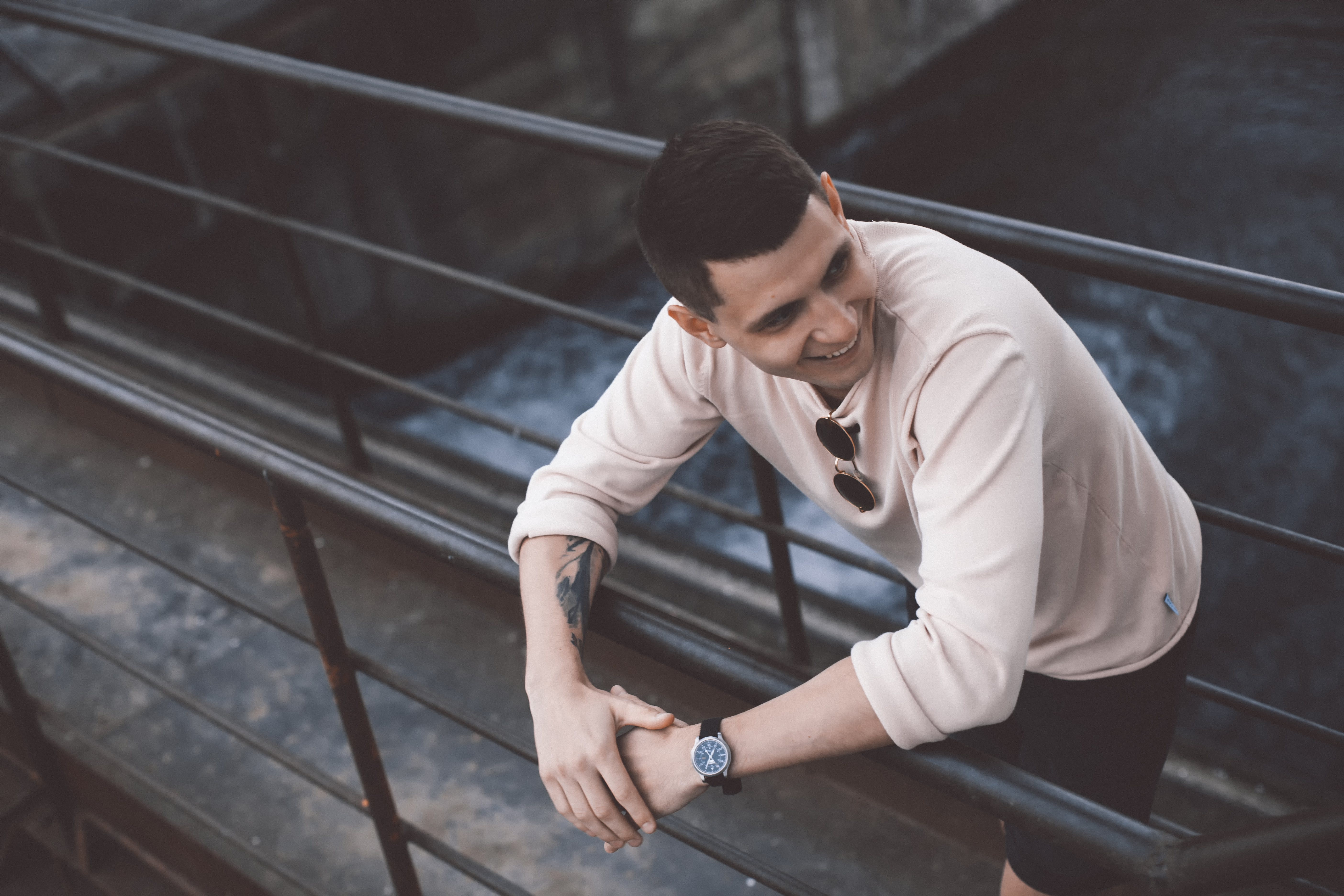 Man Smiling While Leaning On Railings