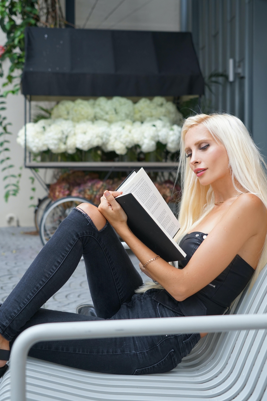 woman reading book free stock photo