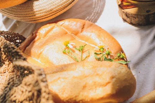 Free stock photo of beautiful flowers, bread, hat