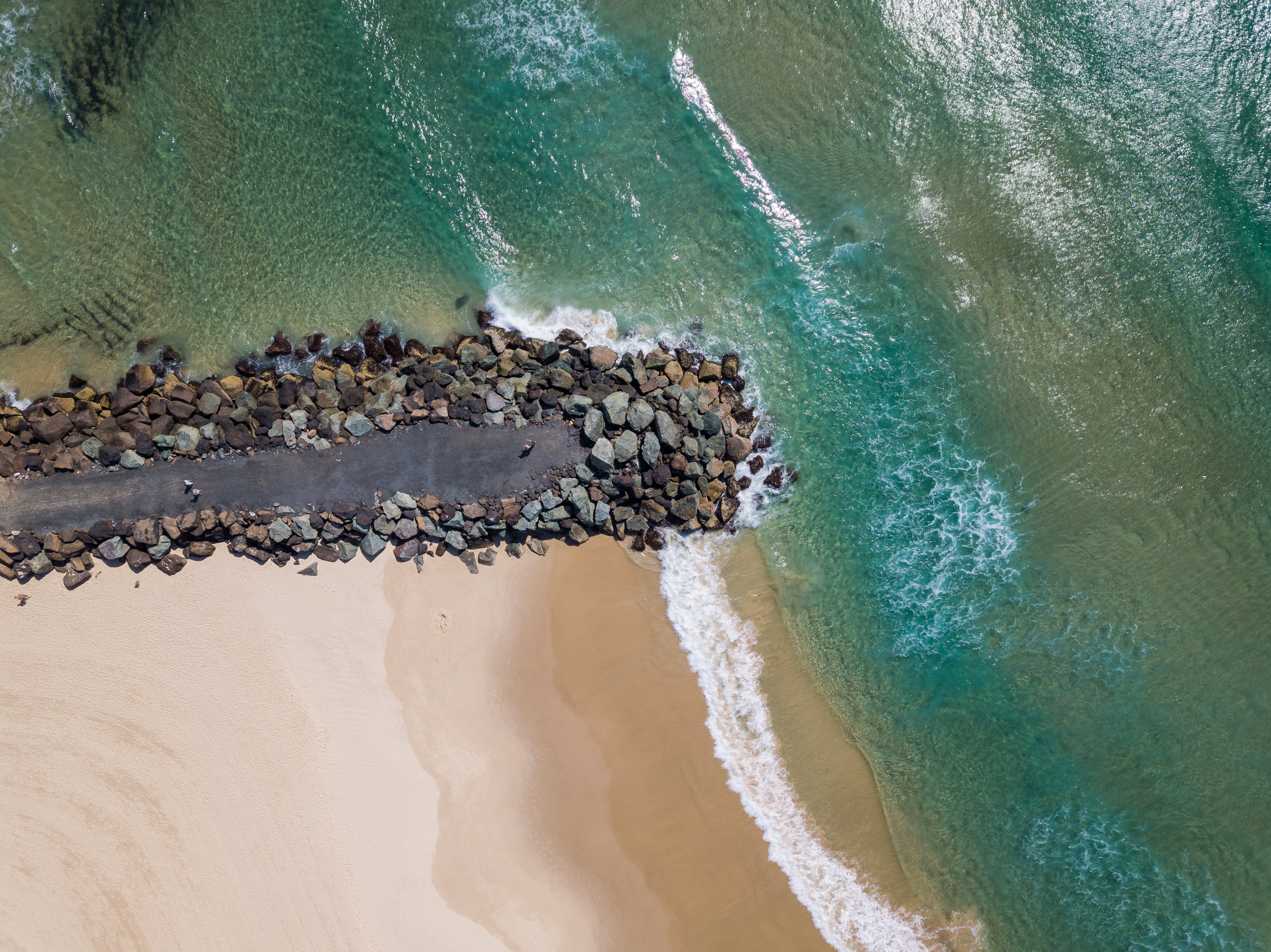 Top View Photo of Ocean and Beach Sand