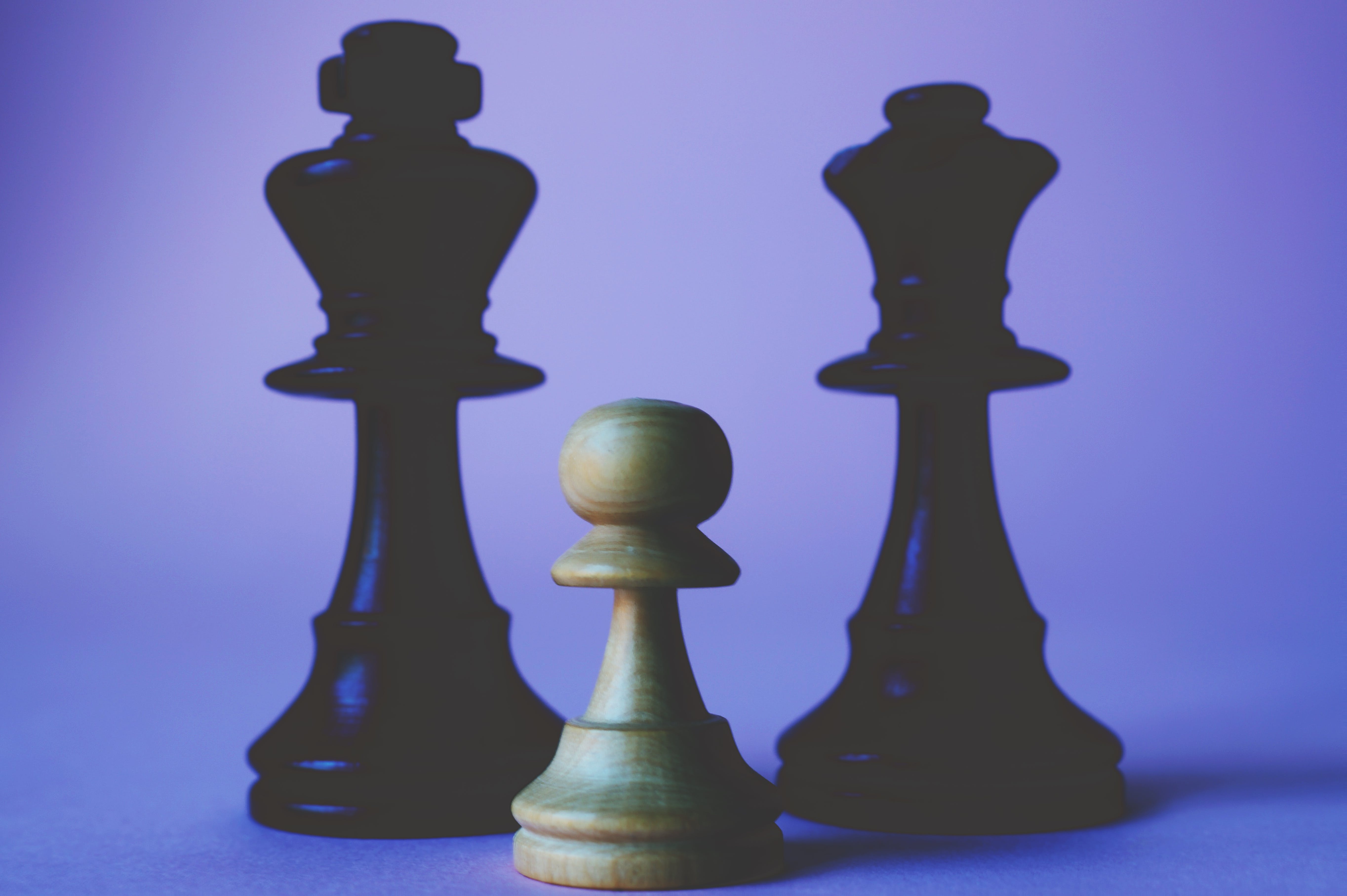 Three Black and Beige Chess Pieces