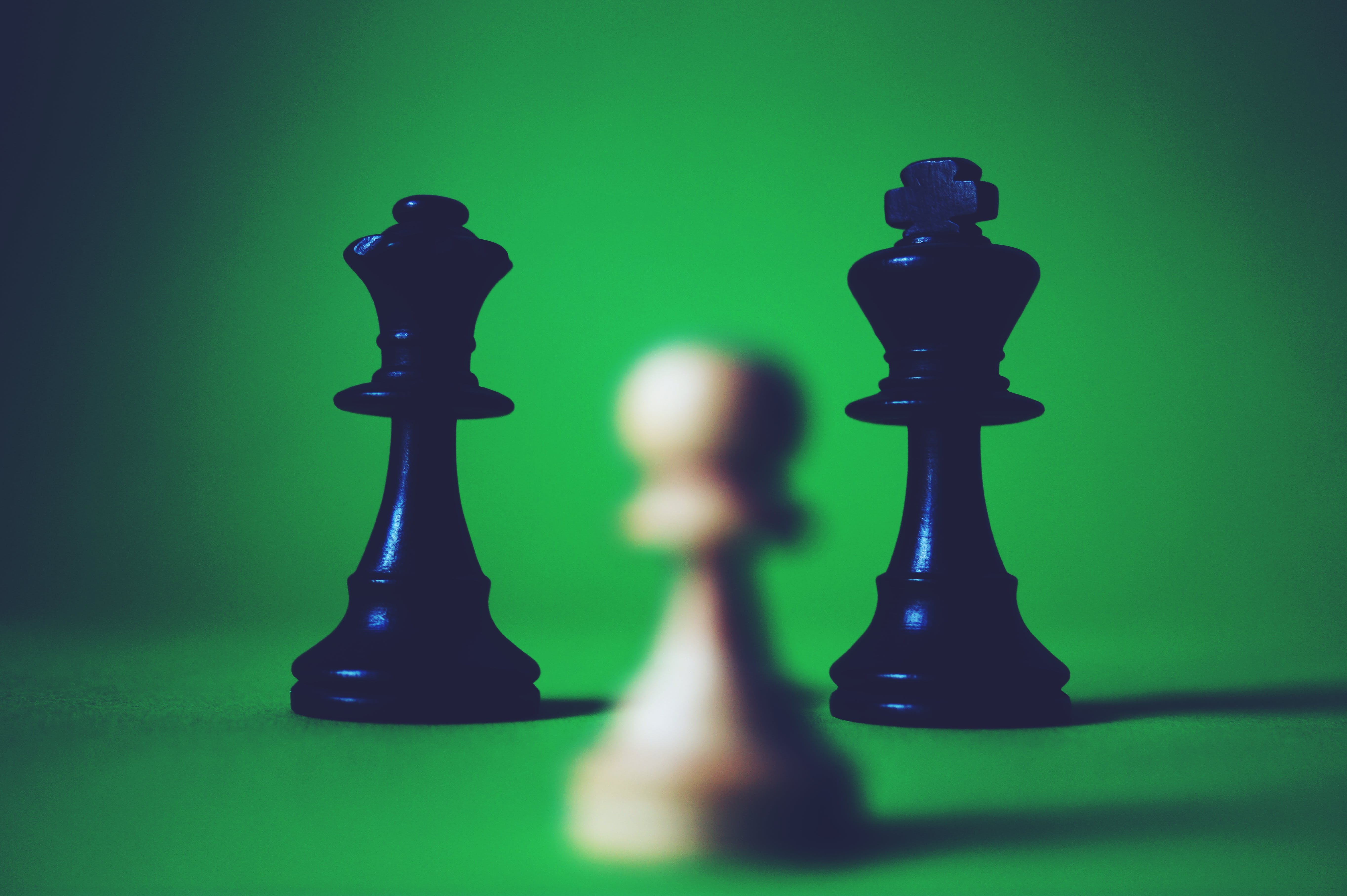 Two Black Queen and King Chess Pieces
