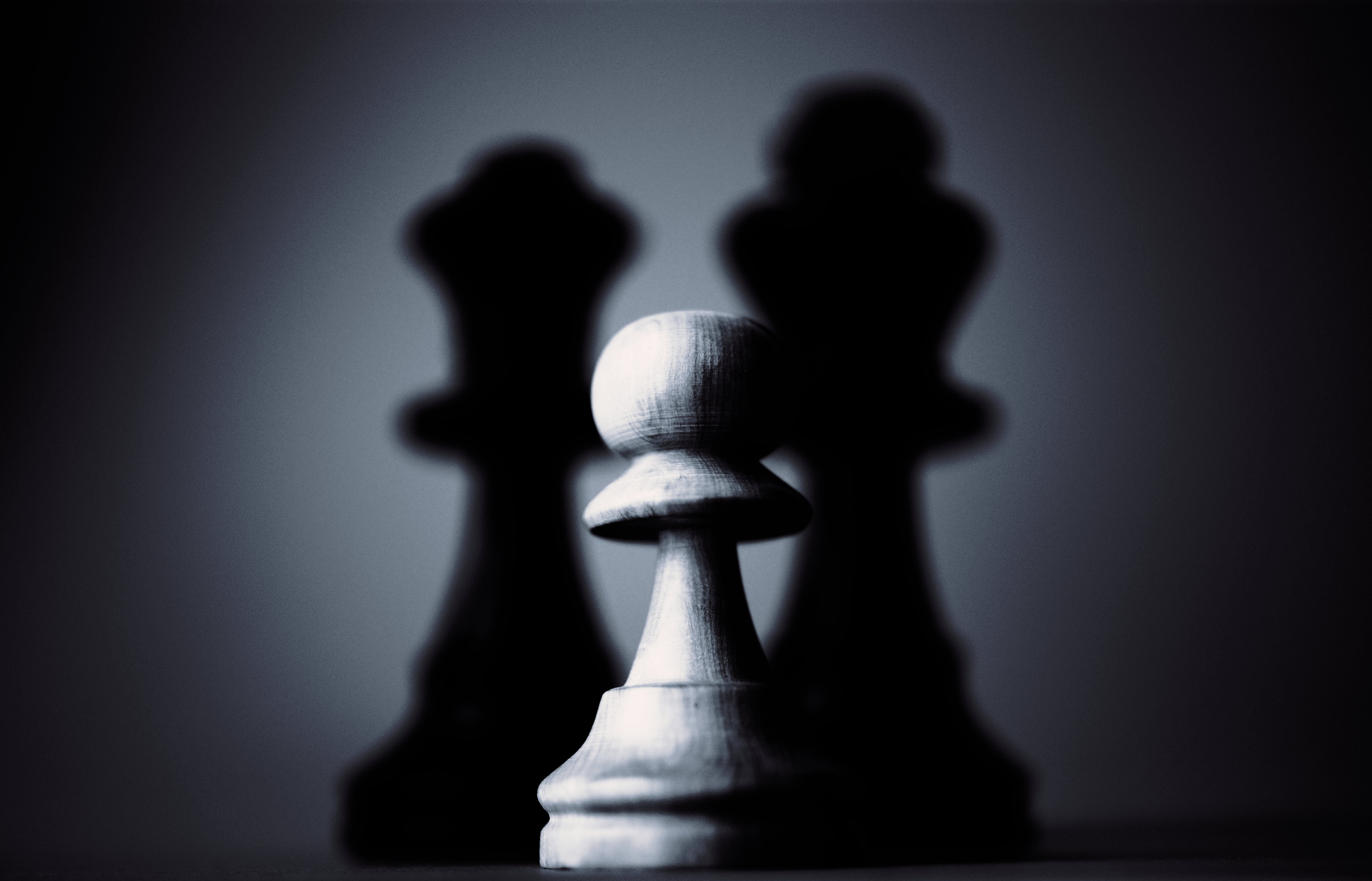 Chess pieces following each other.