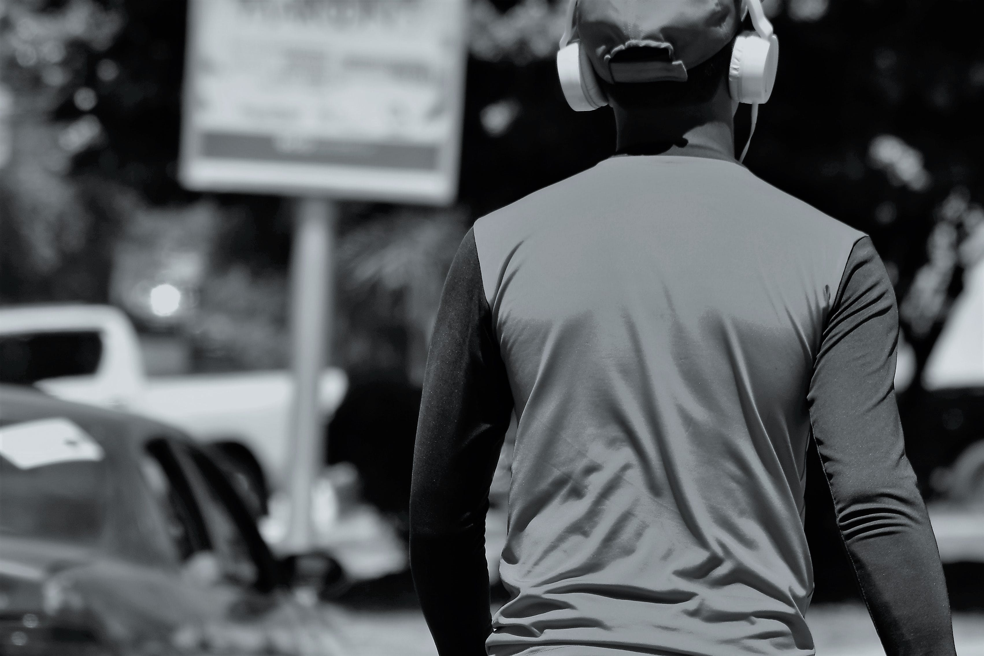 Monochrome Photography of Person's Back