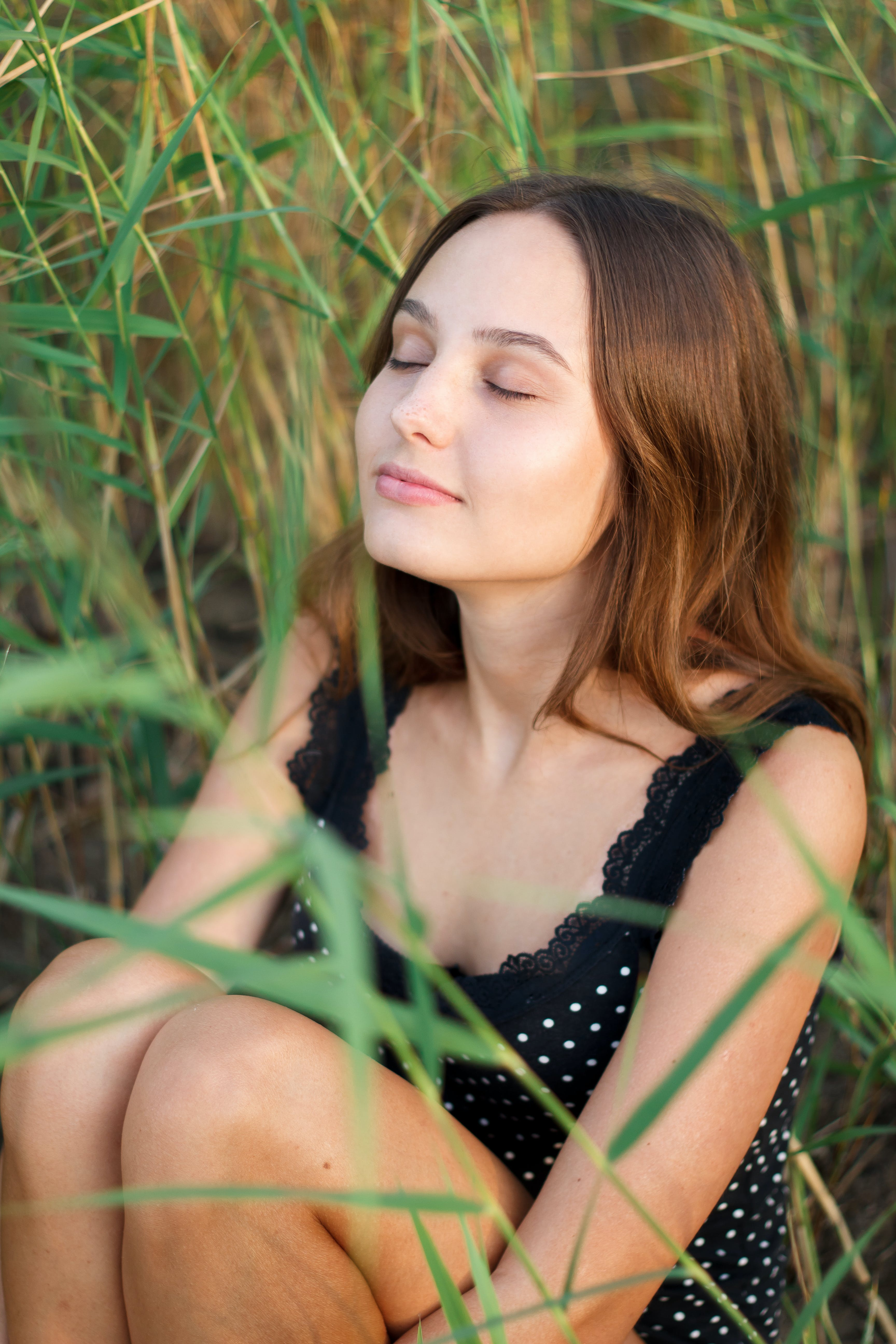 Photo of Woman Sitting on Green Grass