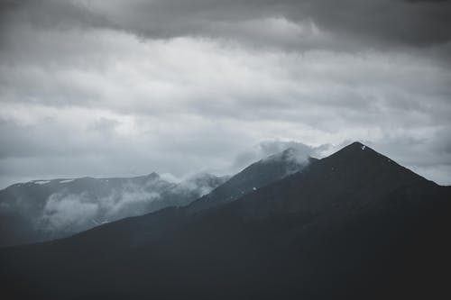 Scenic View of Mountain Under Cloudy Sky
