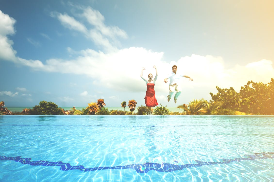 Man and Woman Jump on Water