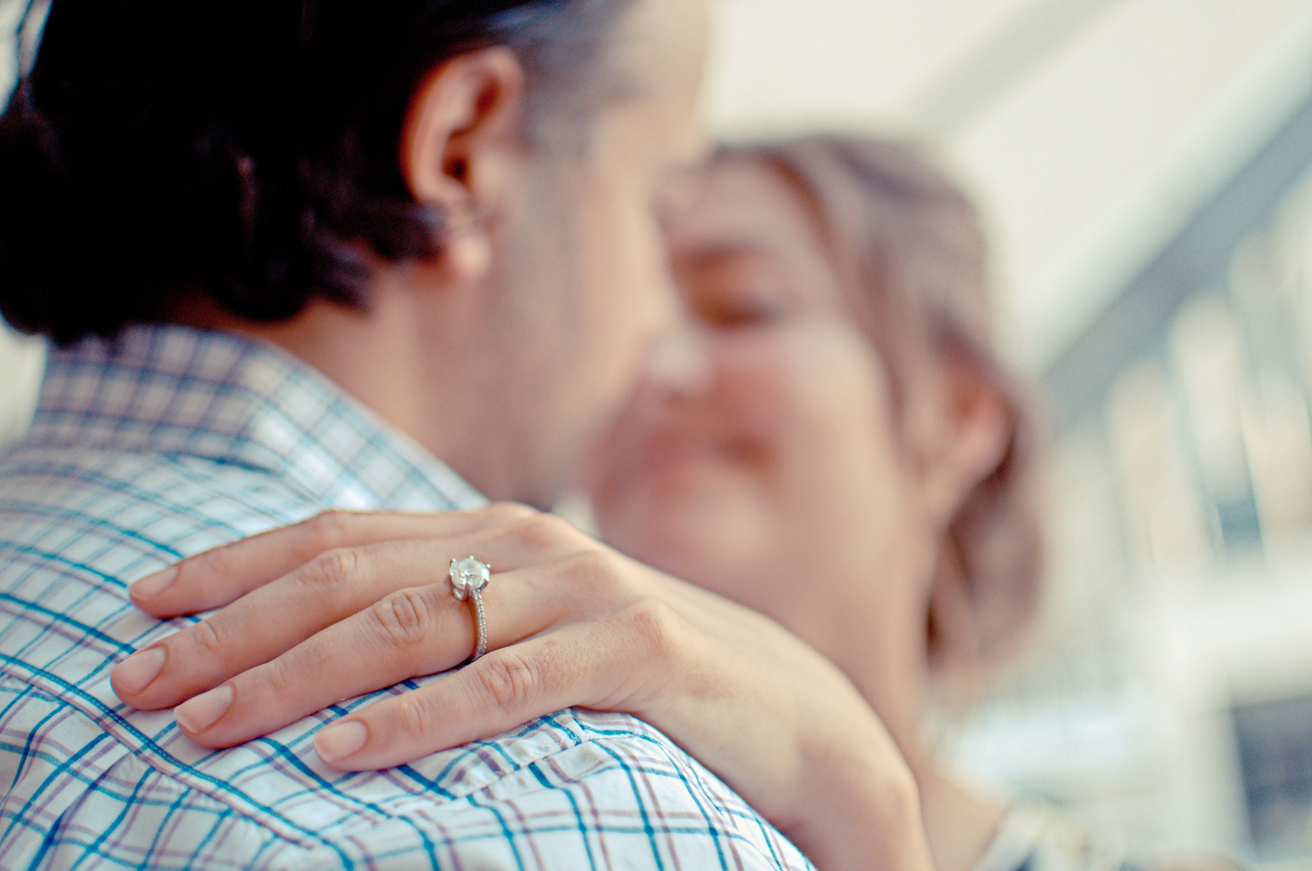 Shallow Focus Photo of Man and Woman Kissing