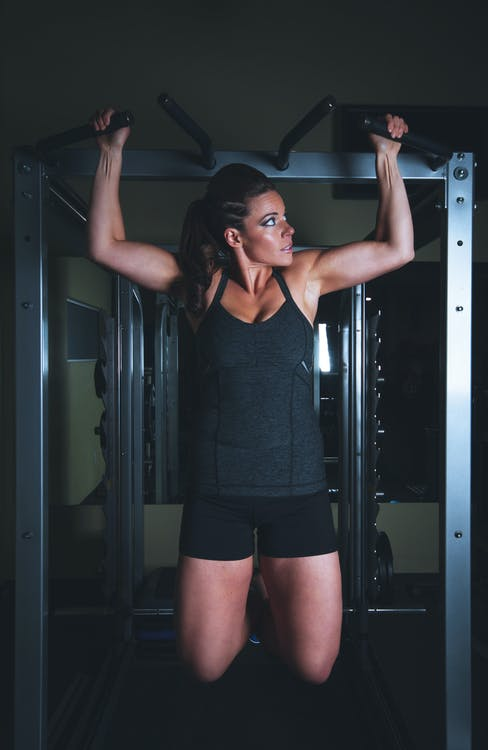 Woman Hanging on Gym Equipment on Focus Photo